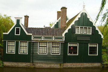rural dutch scenery of small old houses and canal in Zaanse, Net