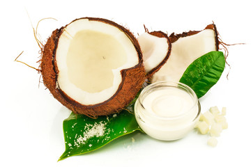 Coconut cocos with cream and green leaves