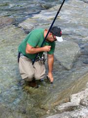 pescatore con trota