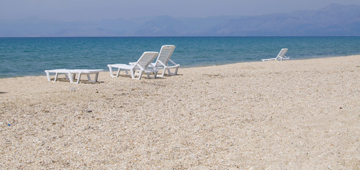 sunbeds on the deserted beach in Corfu, Greece