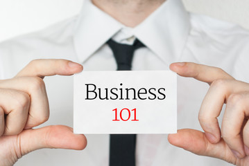 Business 101. Businessman holding business card