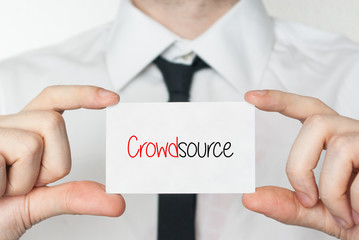 Crowdsource. Businessman holding business card