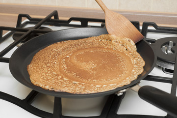 Pancakes cooking in a griddle
