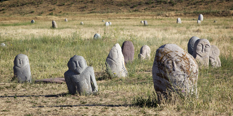 Ancient stone sculptures near Old Burana tower located on famous