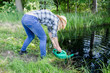 gardener girl draw water from pond