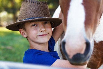 Little boy with pony closeup