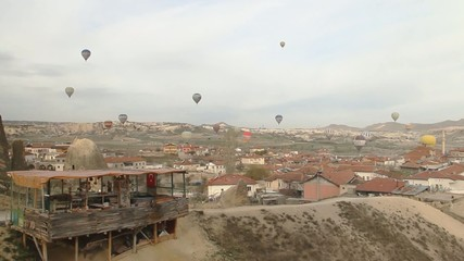 Hot Air Balloons flying over a city