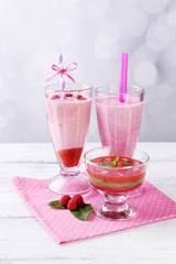 Glasses of tasty smoothies and dessert