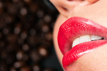 sensual lips on a background coffee beans