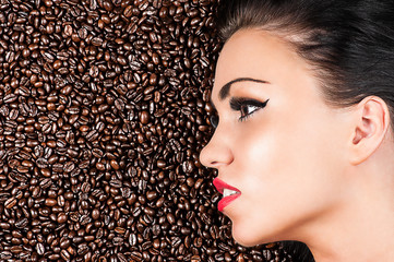 profile of a face of a beautiful woman in coffee beans