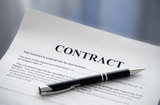 Pen on the contract papers mouse pad