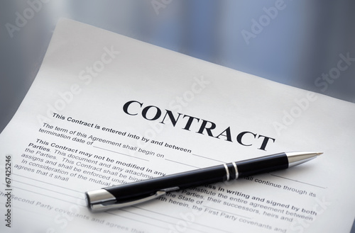 Pen on the contract papers - 67425246