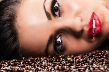 beautiful woman face with coffee beans