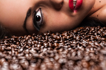 half a woman's face with coffee beans