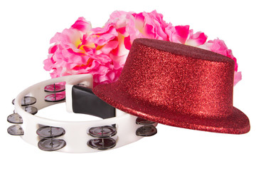 Party hat, tambourine and carnival accessories isolated on white