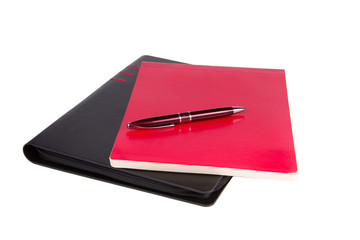Notepad with pen isolated on white background