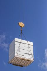 crane lifting stacked white styrofoam sheets 3