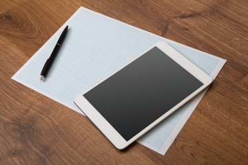digital tablet on a wooden background