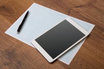 digital tablet on a wooden background