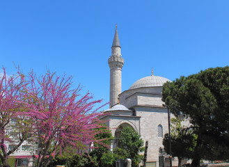 minaret of the mosque on the blue sky background