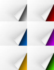 White turned pages on different colors backgrounds