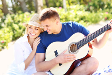 Romantic couple and guitar on the beach