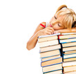 Tired schoolgirl sleeping on stack of books. Education concept