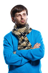 Young man wearing scarf and sweater