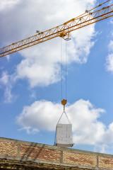 crane lifting stacked white styrofoam sheets 5