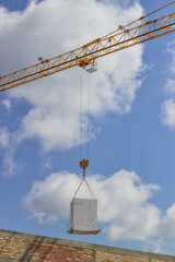 crane lifting stacked white styrofoam sheets 4