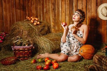 Girl in rustic barn