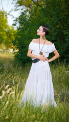 Girl in a White Dress on the Nature
