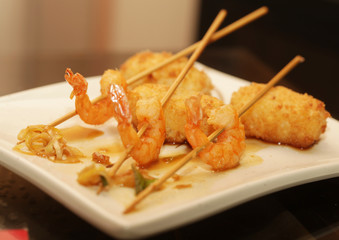 grilled shrimps with rice on white plate