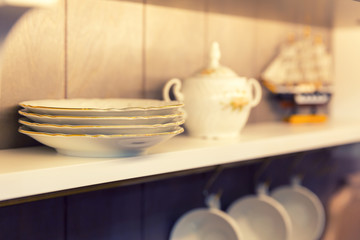 White plates and dinnerware in a cupboard
