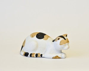 Ceramic cat figurine.