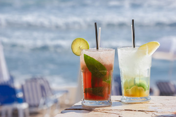 Strawberry and apple  mojito. Blurred sea on background