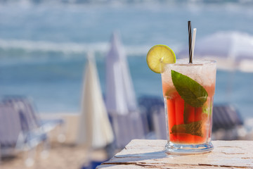 Cocktail. Strawberry cocktail on a beach