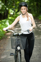Woman in helmet on bicycle trip