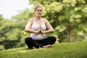 Pregnancy and motherhood-pregnant woman doing yoga