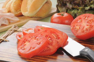 Sliced tomato and sandwich fixings