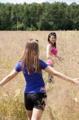 Girls on a field of grain