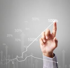 Business man pushing graph