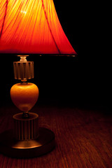 Old-fashioned table-lamp in low key style
