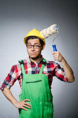 Funny painter with hardhat and roller