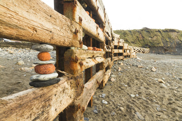 Aberiddy Beach, remains of sea defences, with artistically arran