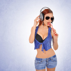 Sexy young woman listening to music