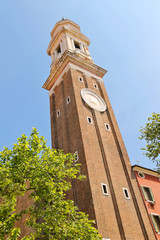 The clock on the Church Saint Apostoli bell tower of  in Venice,