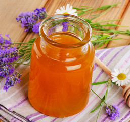 Glass jar of honey