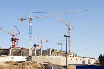 buildings under construction with cranes.