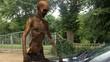 walking dead undead zombie walks behind a car